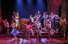 """""""The Bandstand"""" at Paper Mill Playhouse stars Laura Osnes (at the microphone as Julia) Corey Cott (on the piano as Donny) and the company (PHOTO: Jerry Dalia)"""