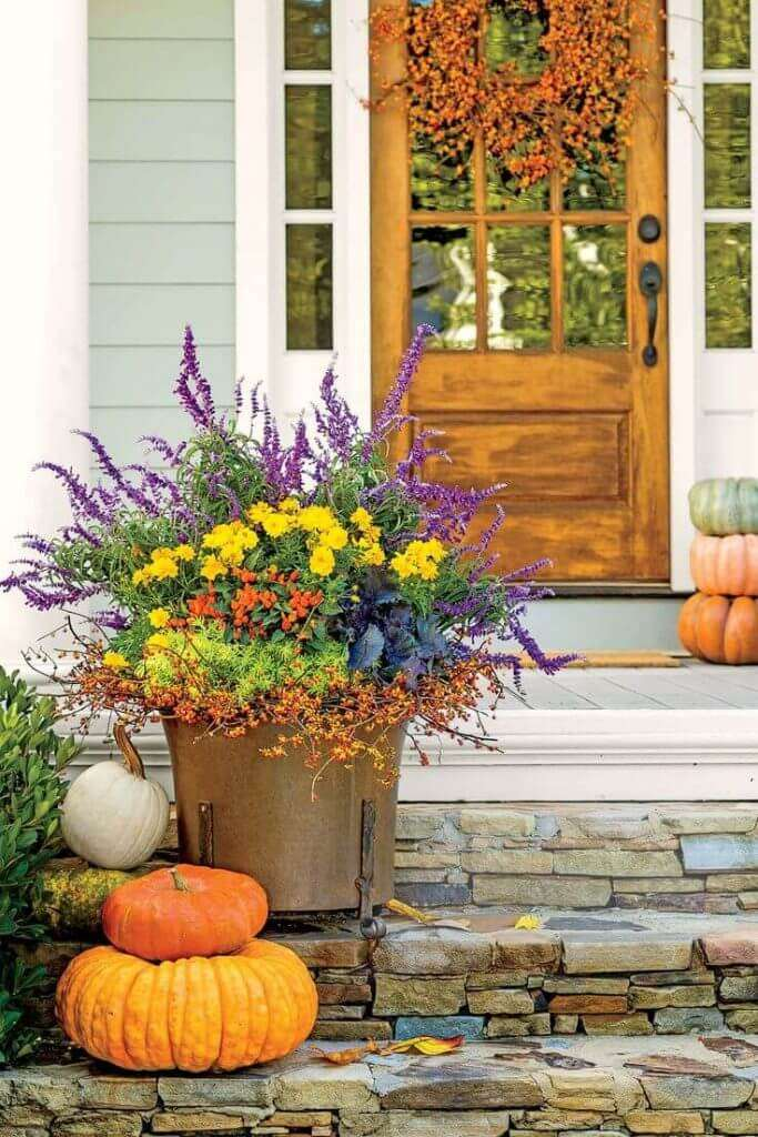 white cottage flower pots at front door