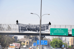 """Banner drop outside the """"Centre for Justice,"""" Santiago in solidarity"""