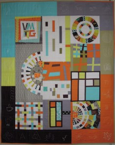 VMQG Logo Colours Group Quilt by VMQG members, photo by Terry Aske