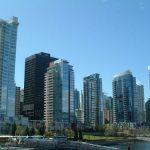 Line of skyscrapers along the water at Coal Harbour