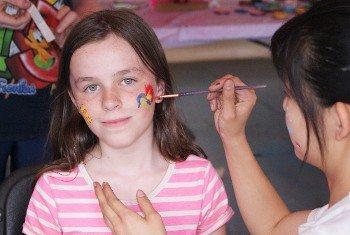 Boy Spray Painting at Kids Festival