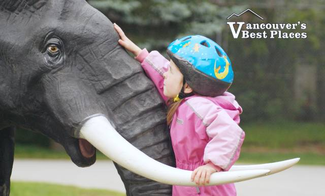 Girl on Zoo Elephant Statue