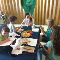 Slytherin House kids at snack table