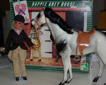 Sindy in Pony Club with dapple horse.