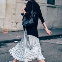 Le-Fashion-Blog-25-Ways-To-Wear-Adidas-Sneakers-Sweater-Stripe-Midi-Skirt-Blue-White-Stripe-Street-Style-Via-Tommy-Ton