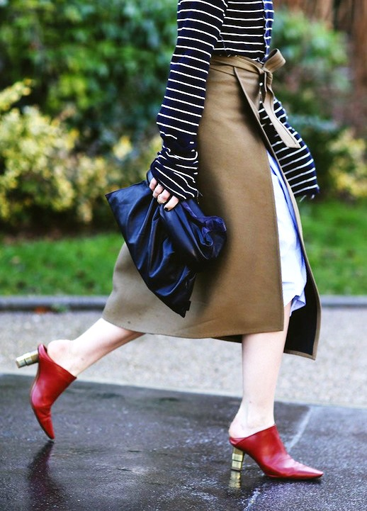 Le-Fashion-Blog-Street-Style-Spring-Layered-Look-Oversize-Stripe-Top-Brown-Apron-Wrap-Over-A-Blue-Skirt-Black-Leather-Clutch-Red-Mule-Heels-Via-Refinery29
