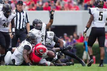 October 15th, 2016 – The Commodores defense makes a stop during their 17-16 win against the University of Georgia in Sanford Stadium Saturday afternoon.