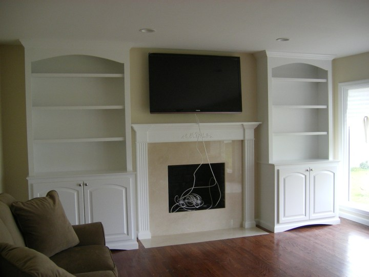custom built in storage and fireplace mantle