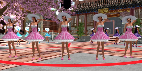 """5 avatars in identical """"Peggy Sue"""" latex dresses stand under a cherry tree and a countdown timer at Chinese College, Monash University"""