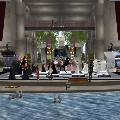 Human (Avatar) Chess players stand on a giant chess board in the courtyard of the Frank Lloyd Wright Virtual Museum.