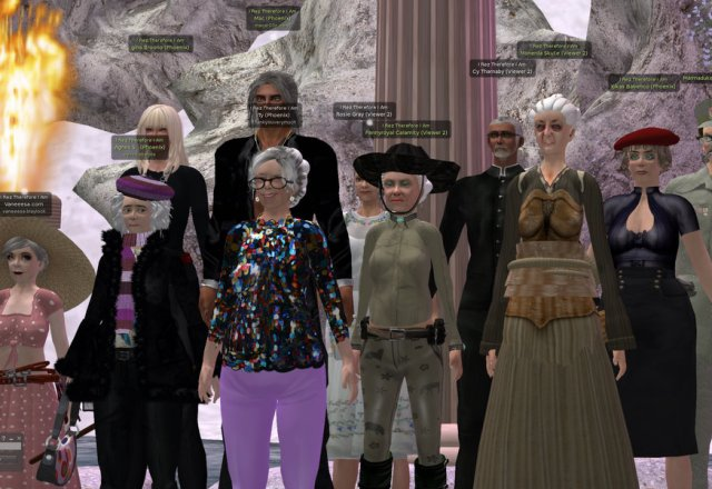 VBCO Cast Members stand on the central mosaic at VBCO Villa at Biscuit Bay, An Li. Each cast member has imagined their future as an avatar senior citizen.