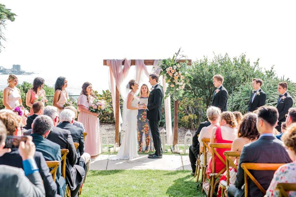 bride and groom getting married at Martin Johnson House