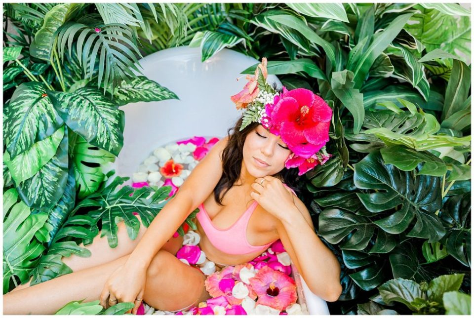 floral tub session in san diego with pink flowers