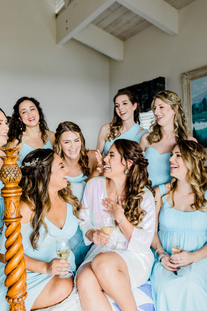 bride with bridesmaids in blue dress
