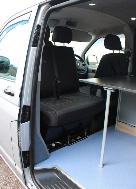 Sliding table pulled up to the double seat with swivel
