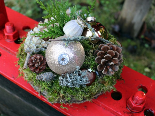 Christmas arrangement moss cones and baubles nature-inspired