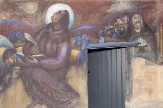 Joep Nicolas in Asselt, zuiderportaal, Johannes die zijn visioen van de Openbaring opschrijft