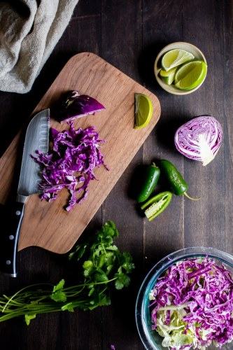 A weeknight staple, Roasted Cauliflower Tinga Tacos with Chili-Lime Slaw are chipotle spicy, and packed with flavor. They're freezer friendly and done in about 30 minutes! Serve with your favorite Mexican inspired sides and don't forget the guacamole! #vegan + optionally #glutenfree  #Tacos #recipe #Vegetarian