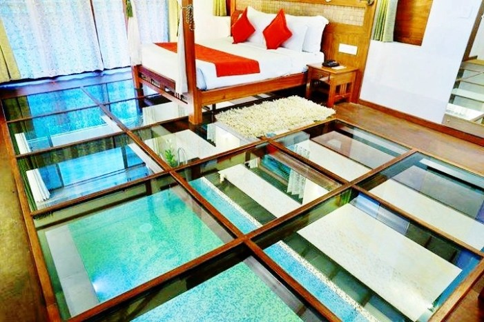 glass floor hotel room - Vythiri Resort Wayanad