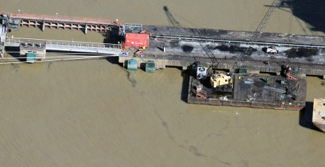 Illegal discharge of Coal and Petroleum Coke into the Mississippi River at the United Bulk Terminal in Plaquemines Parish, Louisiana. Photo: Jonathan Henderson Vanishing Earth. Flight Provided by SouthWings.org.