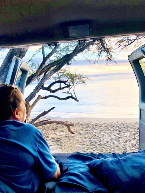 guest from montana enjoying royal blue maui campervan rental vanlife