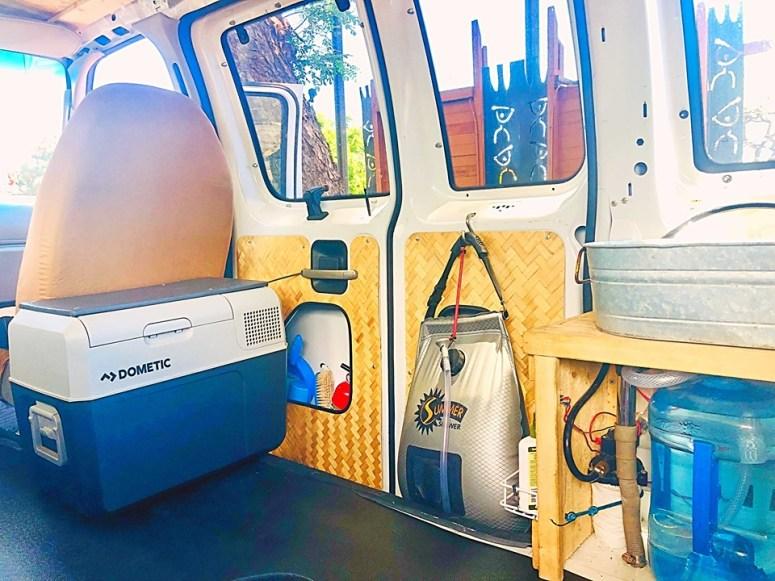 5 gallons solar shower vanlife maui cloud 9 campervan rental water pump sink pressurized water refrigerator 12 volts tiki theme