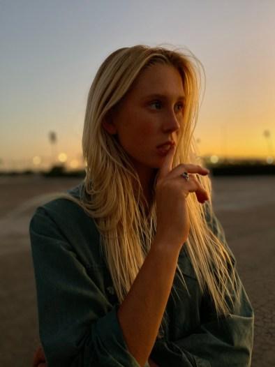 Apple_iPhone-11-Pro_Portrait-Woman-Sunset_091019