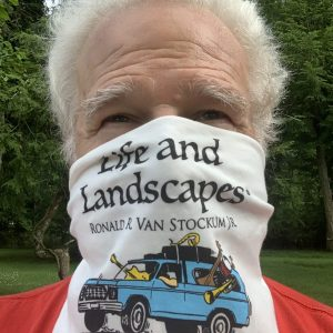 Image of Reggie Van Stockum, Jr. wearing a bandana mask with the Life and Landscapes logo
