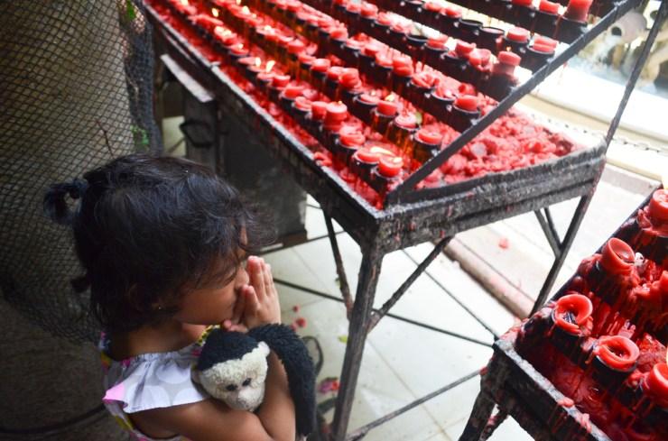 praying at santo niño