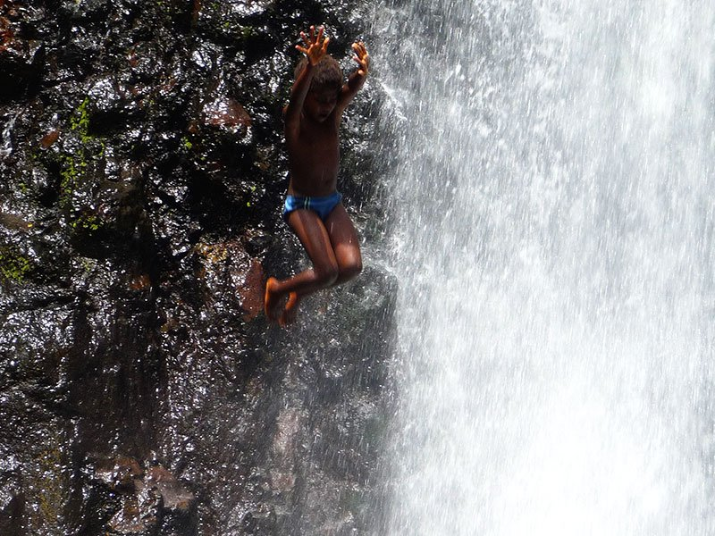The First or Lenuanatuaiu Waterfall is a favourite swimming hole for the local Ni-Vanuatu children living on the surrounding Kastom Lands