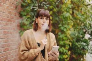 lady vaping e-cigarette