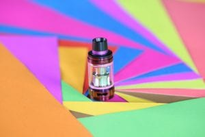 e-liquid tank on color background