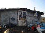 Hütte einer Mutter mit drei Kindern am Rand der Müllkippe