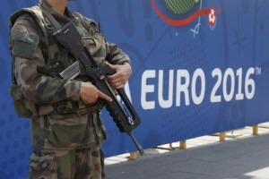 A soldier patrols outside a fanzone ahead of the UEFA 2016 European Championship in Nice