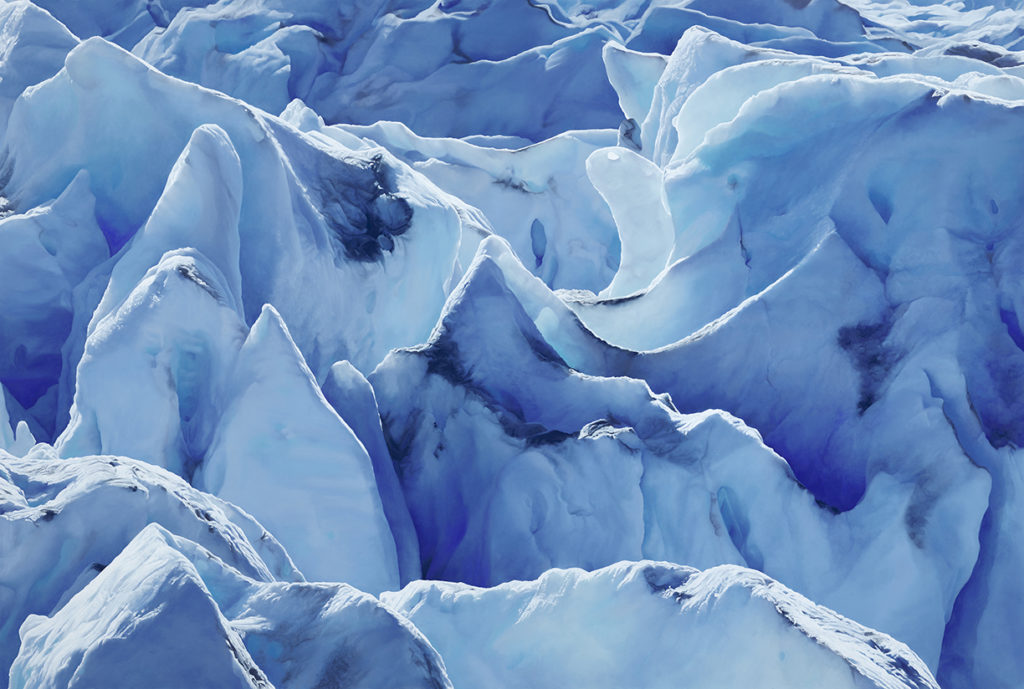 A photorealistic drawing made with soft pastels depicting a close-up view of a glacier. The whole drawing is in blue hues.