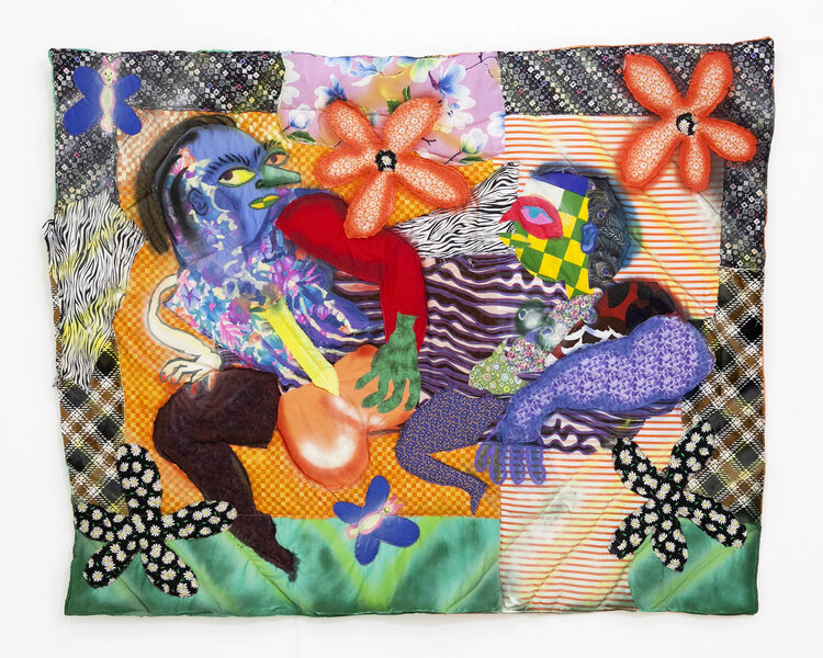 A mixed media work of two human-ish figures rendered in a quilted blanket, embellished with acrylic paint. The figures' forms are abstracted, wiggly, and made of brightly patterned fabric. Flowers and butterflies surround them.