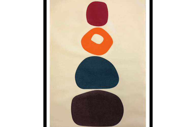 Four circular objects of varying sizes are stacked atop each other, one black, one navy, one warm orange, another red—growing smaller, the higher they're stacked.
