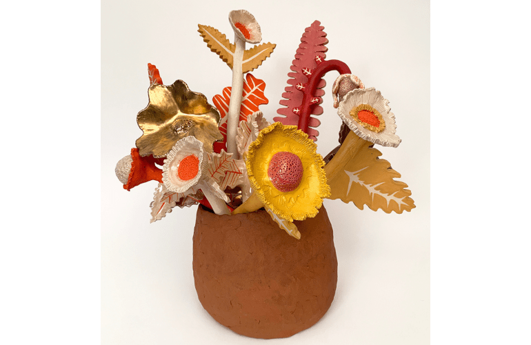 Ceramic sculpture of plants in a vase, some cartoonish, some metallic and modernist, others vibrant and colorful, delicately detailed, disproportionate, impressionistic, playful—all in an earthy clay vase.