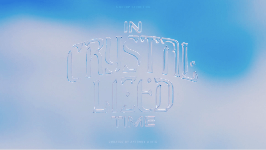 """The words, """"In Crystalized time,"""" in translucent text, hovers before a blurred, ice blue background."""