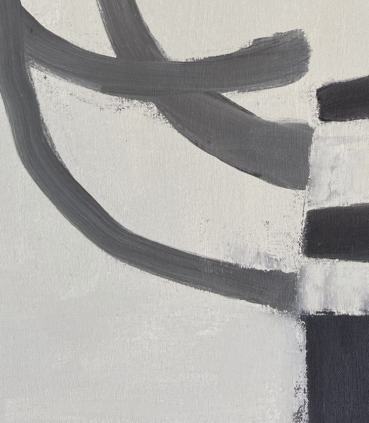 A close up of three dark brushstrokes on a light background, severed in half and redirected.