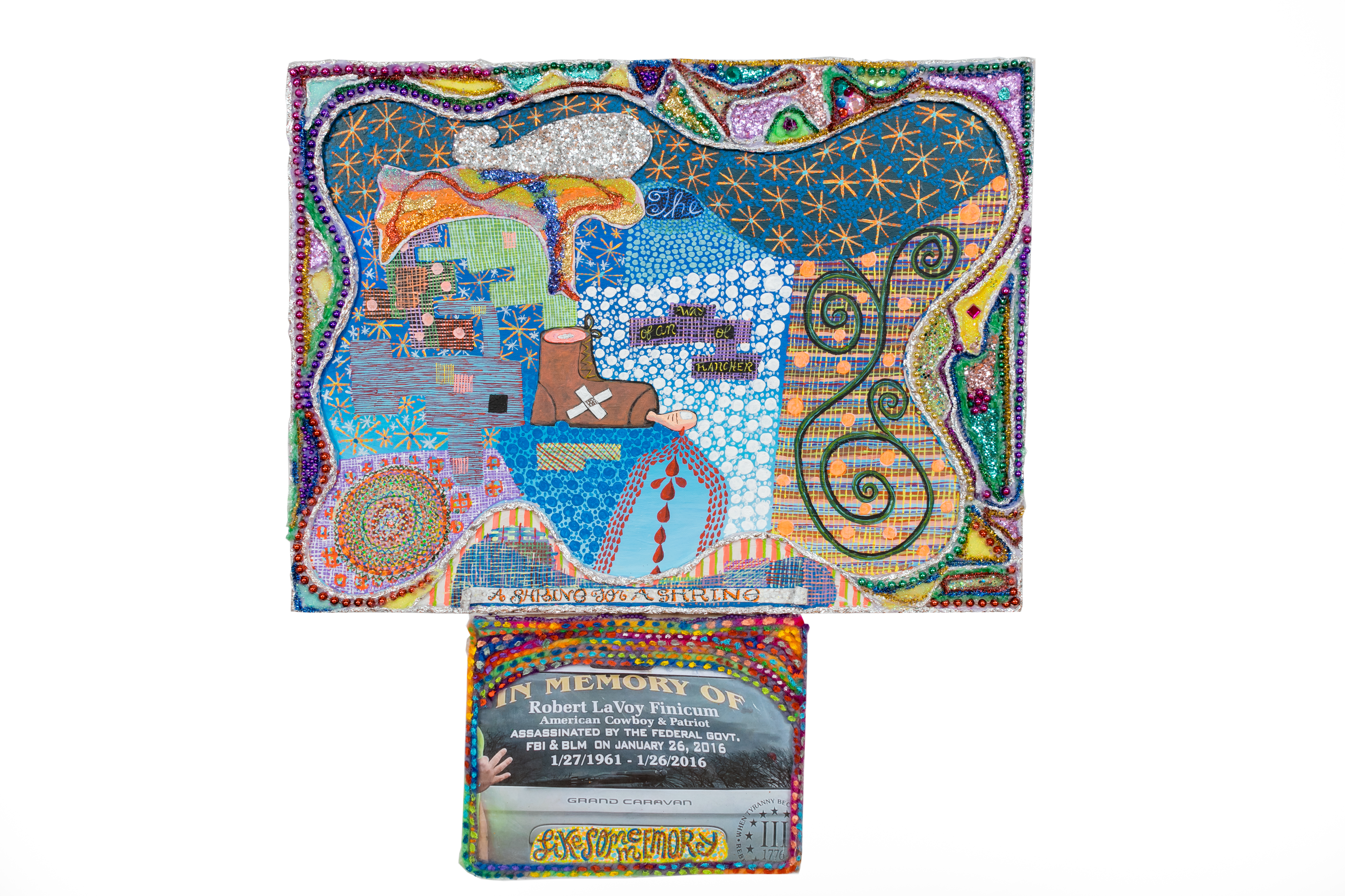 """The words """"A Shrine for a Shrine"""" are painted onto the bottom of a canvas, which combines dizzying patterns of multi-colored paint, multiple glued materials, such as beads and tin foil, as well as a photo of the back of a car, the window of which reads """"In Memory Of Robert LaVoy Finicum."""""""