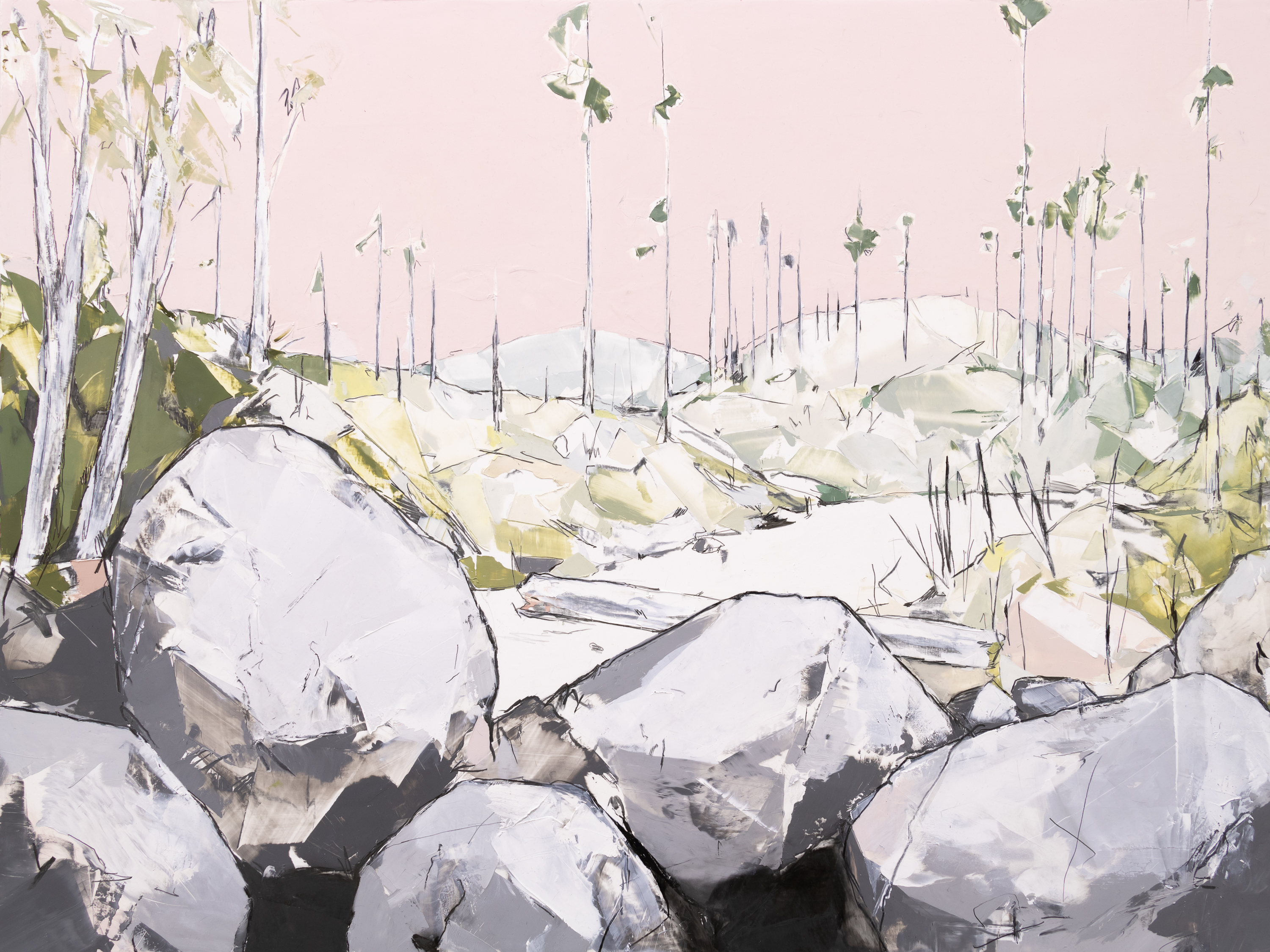 In this lightly geometric landscape, the bare trunks of trees stand sparse against a cream-grey sky, beyond a sharp-edged pile of boulders that dominate the foreground.