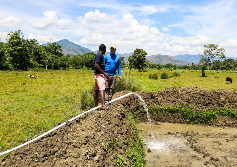 Jeff (our Haitian fish farming leader) and Randy (The American fish farming teacher) filling up a fish pond with water in Haut Limbe, Haiti.