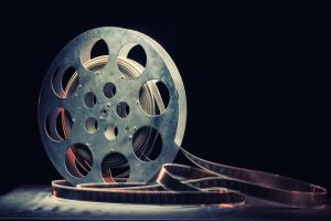 Movie reel on a wooden background.