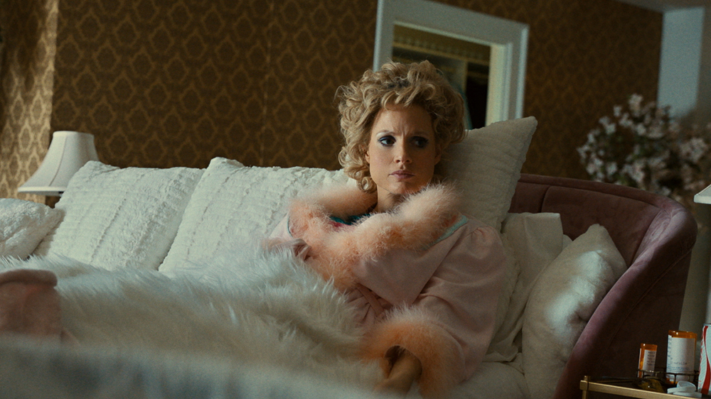 'The Eyes of Tammy Faye' Production Designer Embraced Decadence to Build Tammy Faye's World