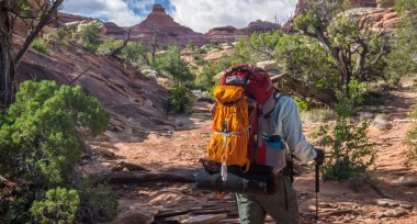Man backpacking in the American west