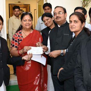 cm receives cheque kerala flood relief