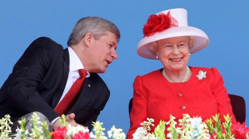 In the photo Harper cracks up the Queen.