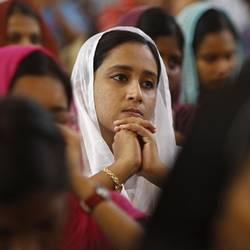 Women attend a mass inside a church to celebrate Easter in Chennai